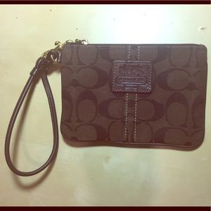 Chocolate colored Coach wristlet